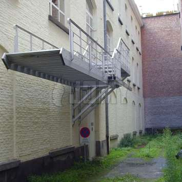 A counterbalance aluminum staircasen in a back alley